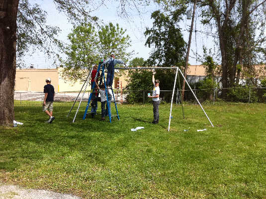 Children painting the swingset?